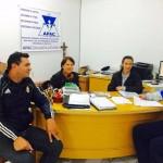 Voluntários da APAC em reunião.